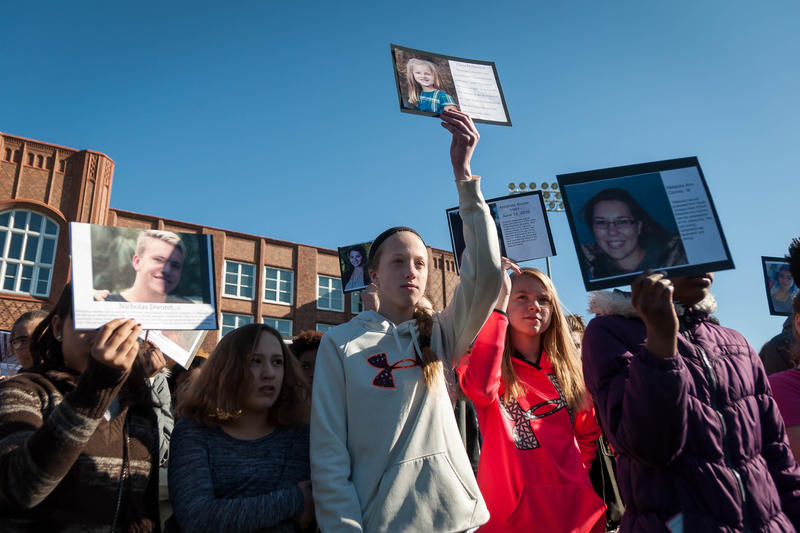 Maplewood Richmond Heights students honor victims killed at a school shooting in Parkland, Florida, last month during a walkout Wednesday, March 14, 2018.