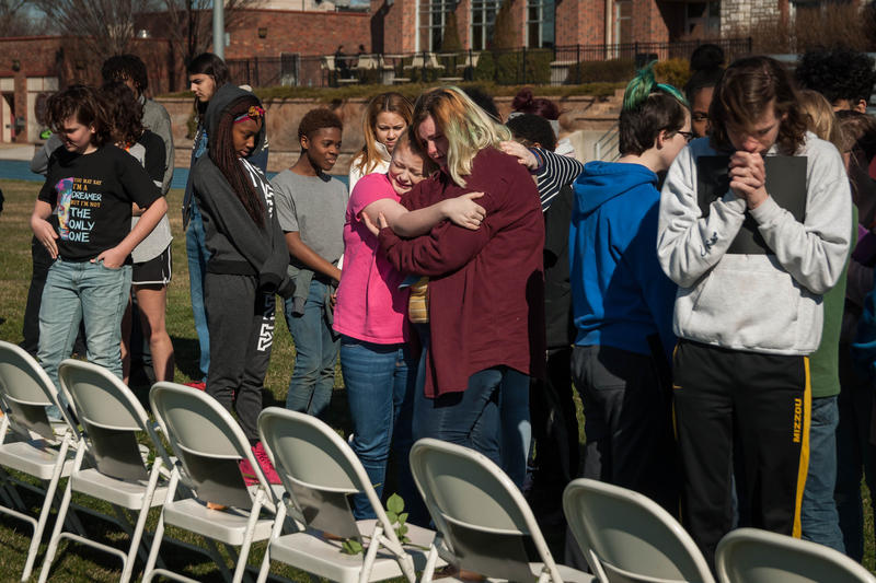 Students at Maplewood Richmond Heights embrace during a demonstration for gun safety in honor of the victims of the Parkland, Florida, school shooting.