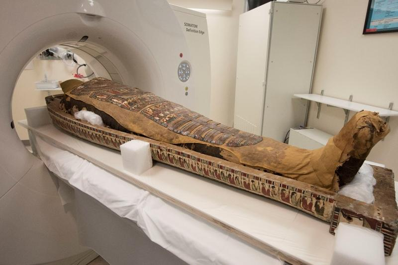 An ancient Egyptian mummy named Pet Menekh is placed in a CT scanner at the Washington University School of Medicine.
