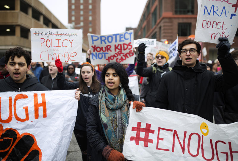 Mitali Sharma, center, marches with Clayton High School classmates in downtown St. Louis.