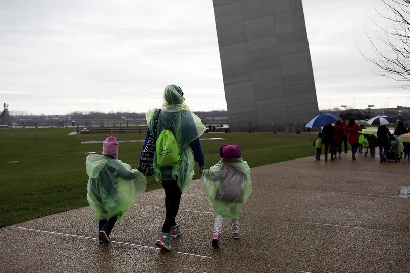 Children from the University City Children's Center walk down a new pathway toward the Gateway Arch.