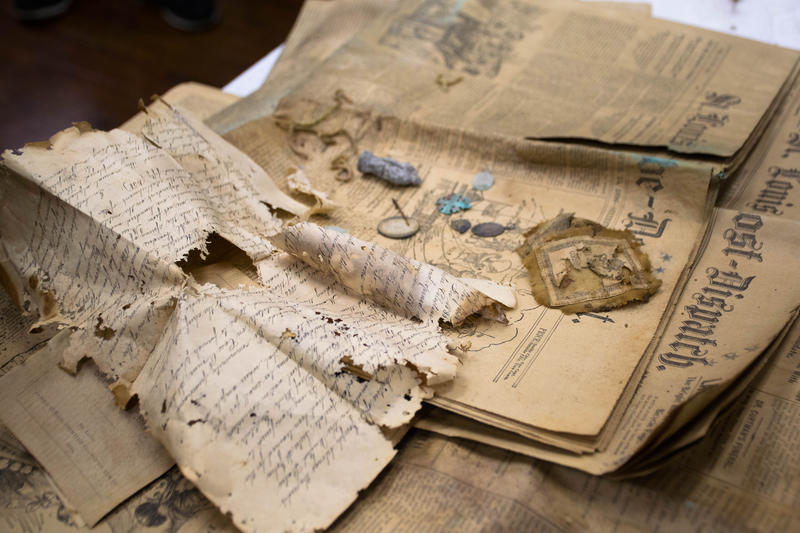 Historical papers and religious items dated back to 1896 filled the time capsule found under the Our Lady of Good Counsel Chapel. Photo from March 28, 2018.
