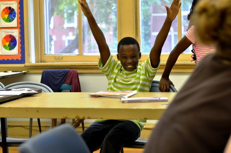 A boy named LaRon enjoys a class at the former Intersect Arts Center building, before the organization moved into its new renovated space.