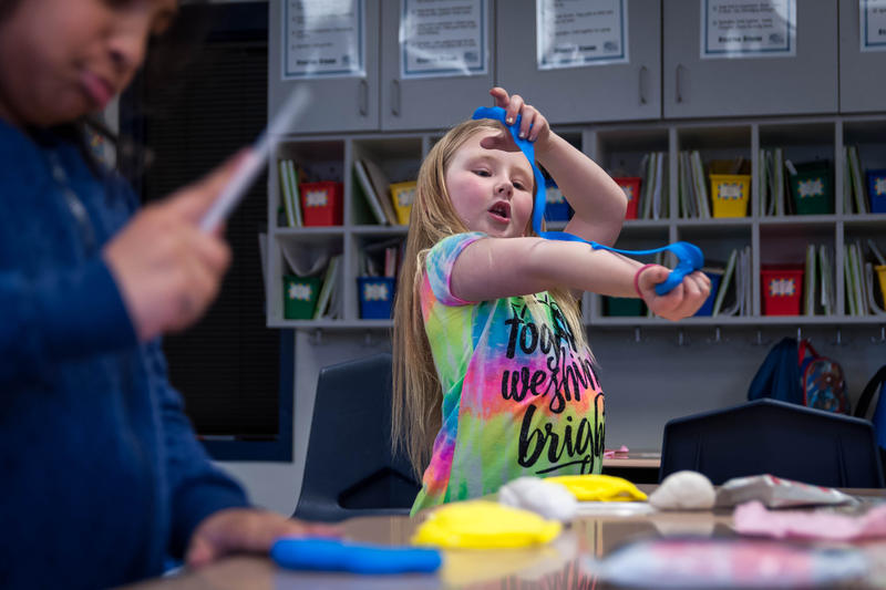 Caitlyn Kalmer, 7, works on her model of the brain during the Little Medical School after-school program at Stanton Elementary School in Fenton.