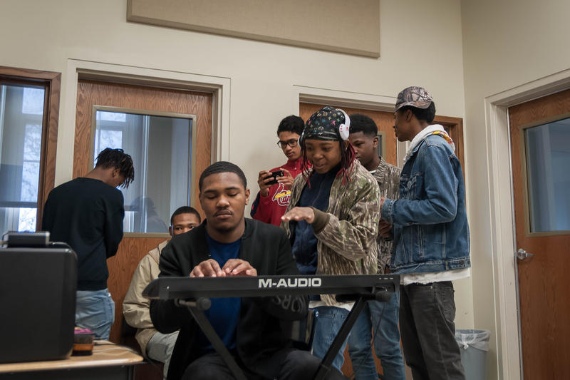 University City seniors Alex Cunningham, sitting, and Kyhler Cross work out a new beat as part of the audio production course Cunningham started last year. April 23, 2018.