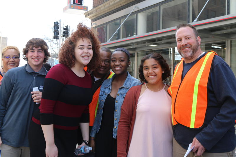 McCluer North social studies teacher Adam Bender (far right) joined by McCluer North students and principals outside the Fox Theatre in St. Louis.
