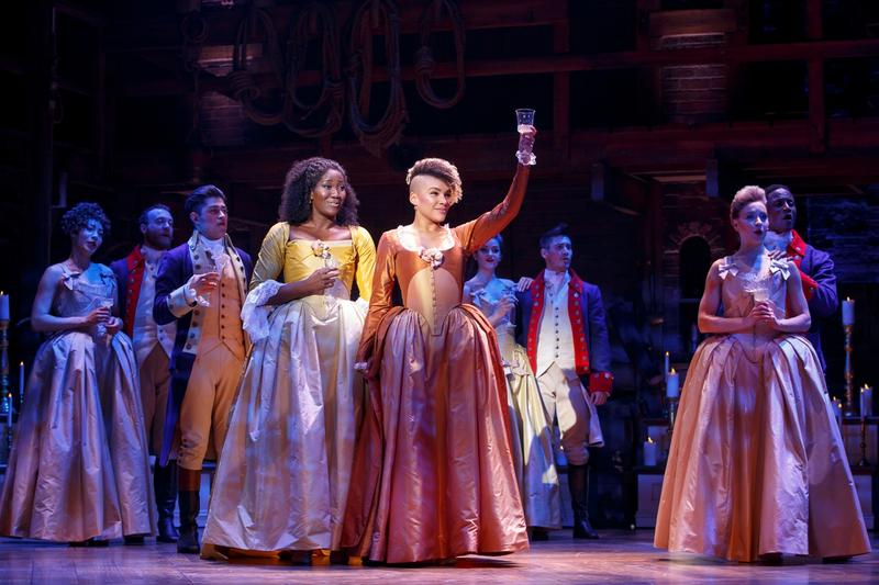 This photo shows Amber Iman and Emmy Raver-Lampman as two of the Schuyler sisters in
