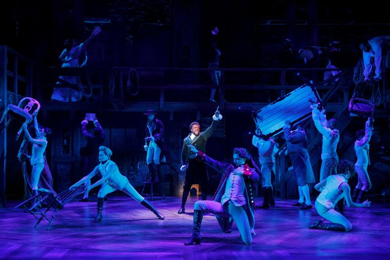 Actors perform a fighting scene in the musical