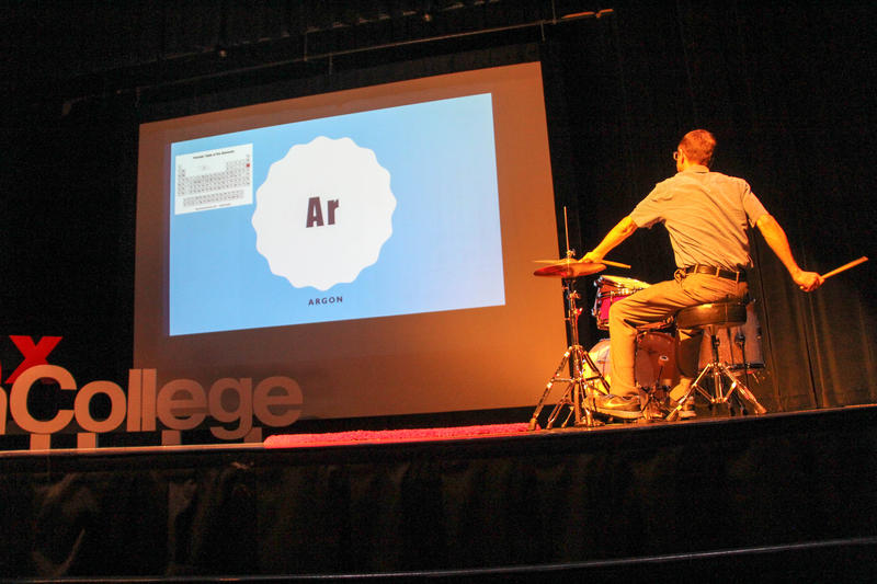 Jefferson College chemistry professor Wesley Whitfield plays the drums at a TEDx event the school organized in April 2018.