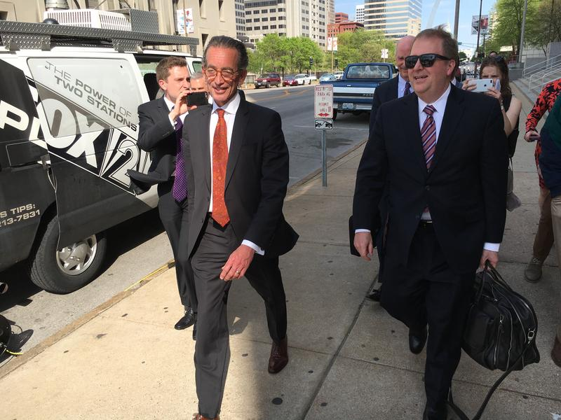 Attorney Al Watkins walks out Tuesday of the Carnahan Courthouse in St. Louis. He's joined by Chuck Hatfield, a Jefferson City attorney who represented him during his two-day deposition.
