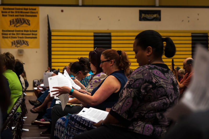 Hazelwood parents read through an audit of the school district's finances done by Missouri State Auditor Nicole Galloway during a community meeting to release the results of the report Wednesday, May 2, 2018.