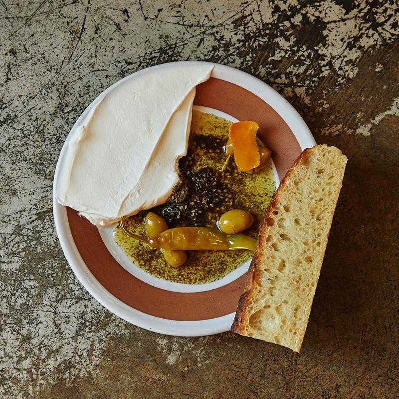 Farmers cheese, olives, pepper, za'atar and olive oil dip with bread from The Benevolent King.