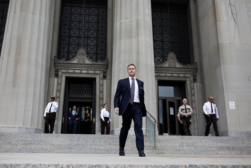 Missouri Gov. Eric Greitens walks out of the Civil Courts Building in downtown St. Louis Monday after his felony invasion of privacy charge was dropped.