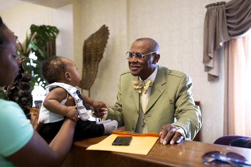 Ronald Jones greets a client's son at his funeral home 2161 E Fair Ave. (May 16, 2018)