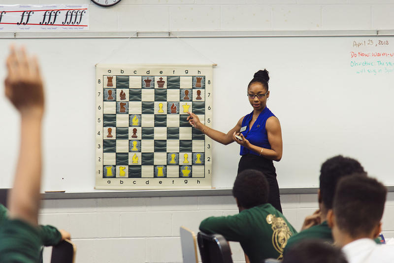 An instructor teaches chess at the Gateway Middle School.