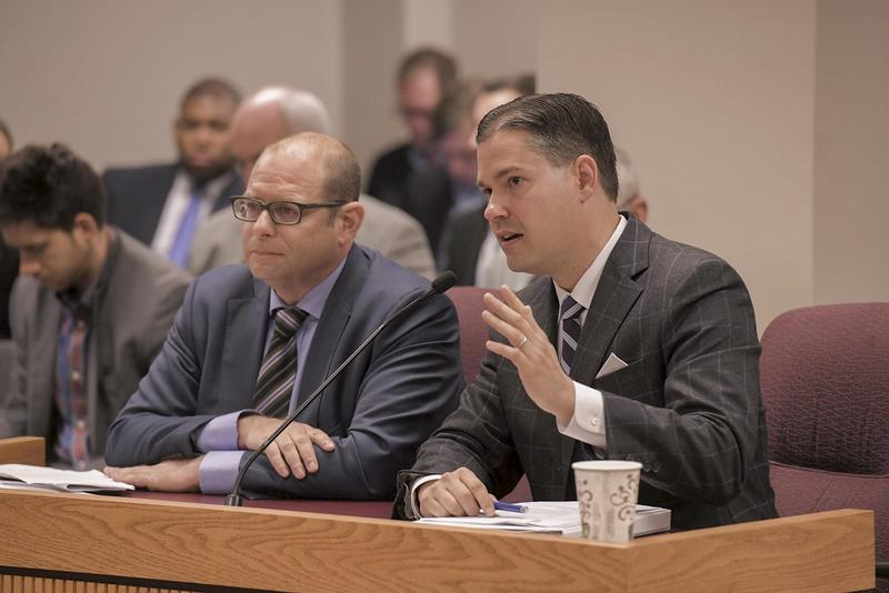 Attorneys Ross Garber and Ed Greim testify under oath at Wednesday's hearing.