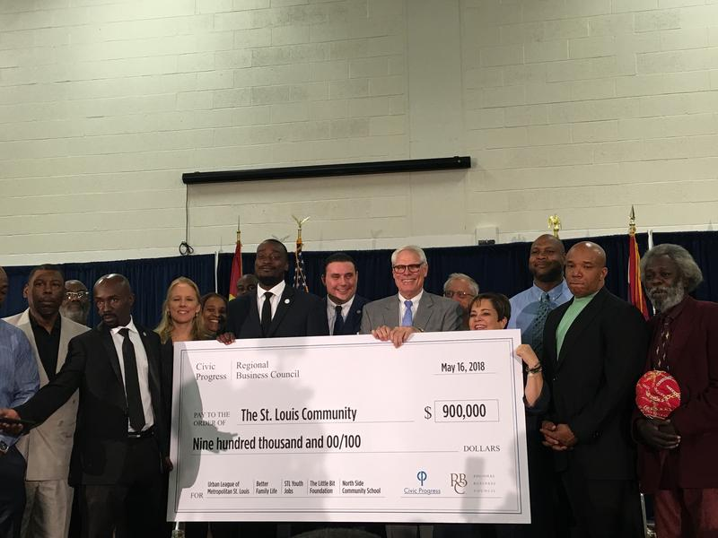 Members of the Regional Business Council and Civic Progress present a $900,000 check to provide job training opportunities for youth programs. The investment aims at improving public safety.