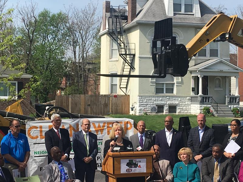 Mayor Lyda Krewson stands with community members at the announcement for the 2018 Clean Up campaign.  The program will kick off this month and will aim at cleaning up four neighborhoods in St. Louis.