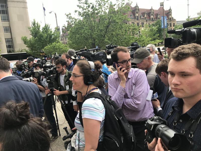 Rachel Lippmann and Jason Rosenbaum (center foreground) outside the Civil Courts building.