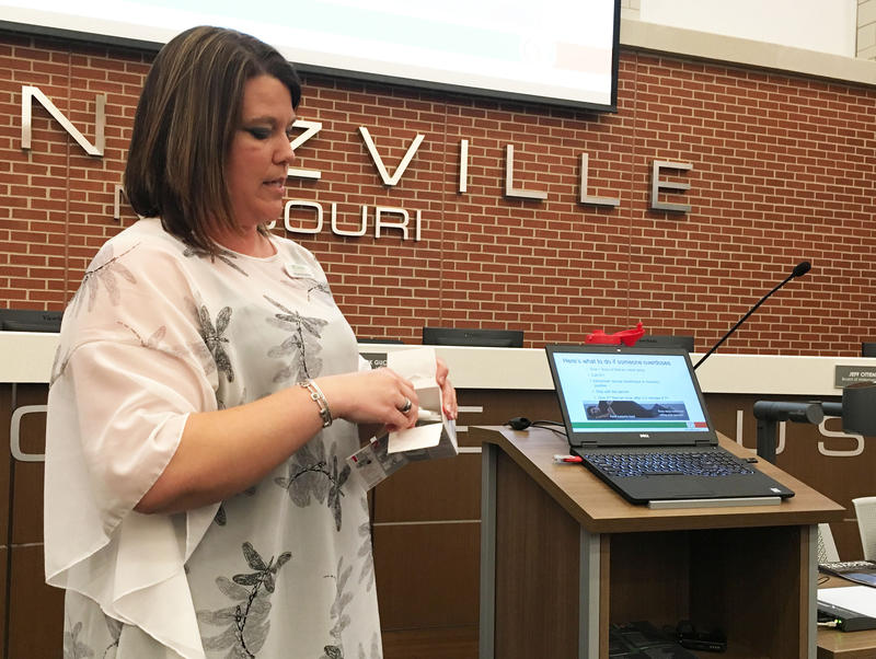 Nicole Browning of the National Council on Alcoholism and Drug Abuse demonstrates how to use Narcan during a public meeting Monday in Wentzville.