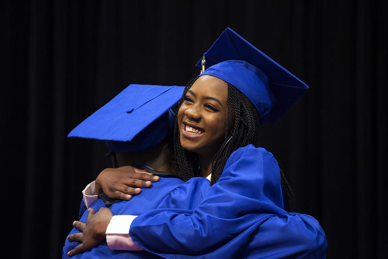Ngone Seck hugs a friend after receiving her diploma at Riverview Gardens High School's graduation ceremony. May 2018
