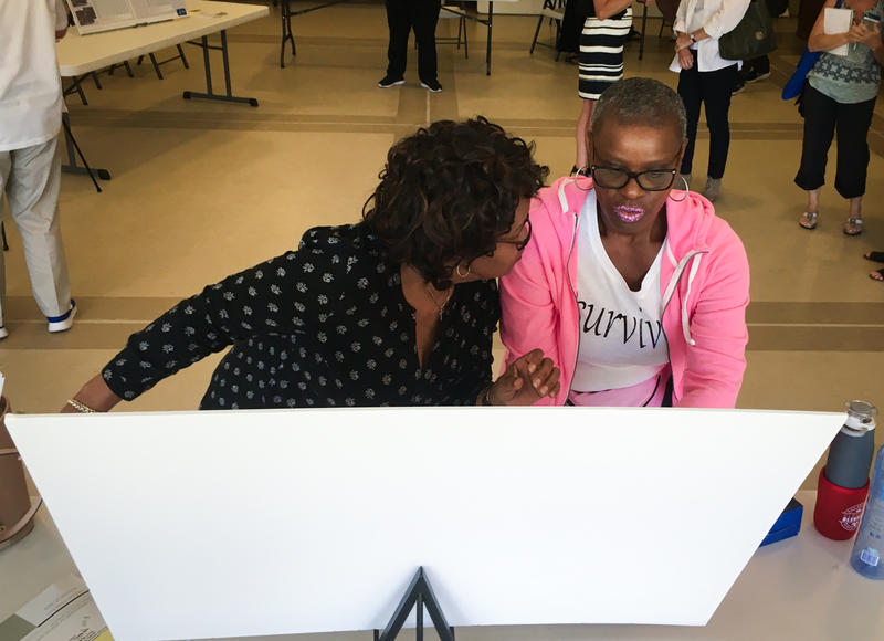 North St. Louis County residents Antoinette Ray and Dorlita Adams examine a map of sediment testing near Coldwater Creek at a public meeting in Florissant held by the federal Agency for Toxic Substance and Disease Registry.