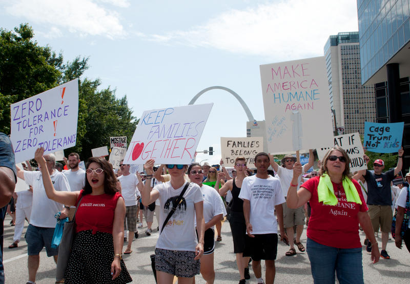 Protesters march down Market Street in downtown St. Louis with handmade signs while chanting