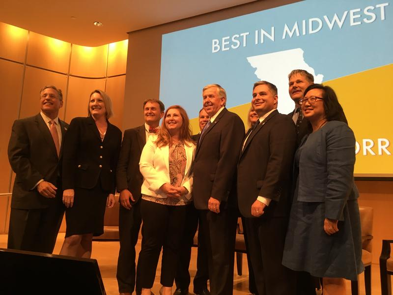 Gov. Mike Parson poses with organizers of the Best in Midwest and Talent for Tomorrow Summit, where infrastructure and workforce development were top of the agenda.