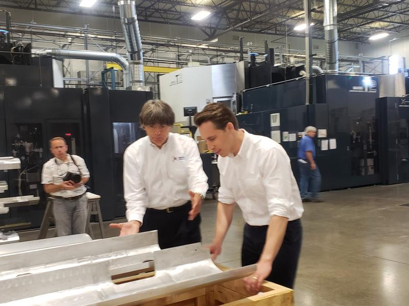 Missouri Attorney General Josh Hawley, right, examines equipment as Patriot Machines vice president Robert Burns gives him a tour of the plant.