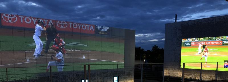 The Cardinals game was projected on the two-story outdoor screen in the Public Media Commons