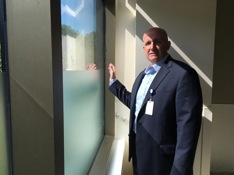 Mercy Hospital's John Farnen demonstrates the laminated safety glass at Mercy Hospital Jefferson's new wing in Festus, Missouri.