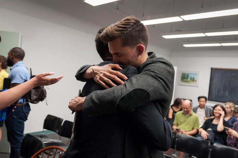 Jack Krewson hugs Gavin Schiffres after the two won sponsorship to open a charter school in St. Louis' Dutchtown neighborhood Wednesday, July 11, 2018.