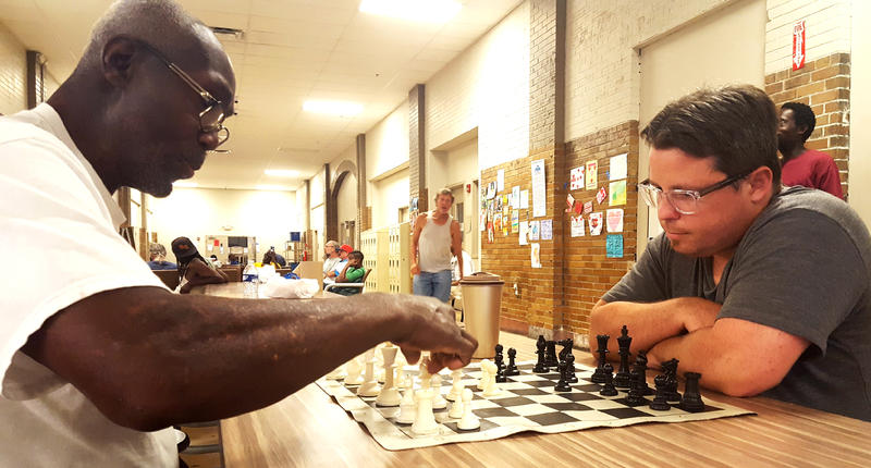 Volunteer Sam Roth, right, plays chess with a Biddle House shelter resident on July 9, 2018. The chess club began in 2016, the same year the shelter opened.