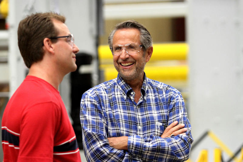 CEO Bob Chapman, right, talks to an employee at a Barry-Wehmiller factory.