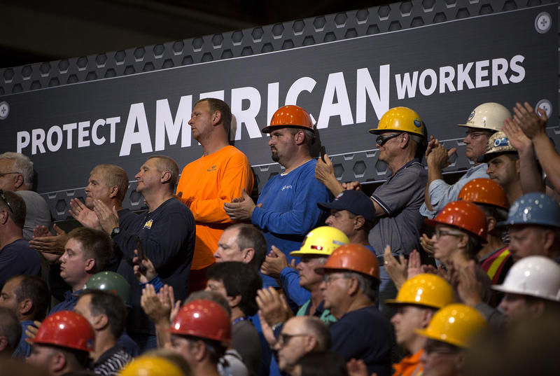 Attendees listen as President Donald Trump speaks at a Granite City Works warehouse. July 26, 2018