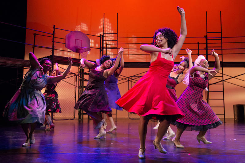 RhonniRose Mantilla, wearing a red dress, rehearses Thursday night for an upcoming community production of West Side Story in July.