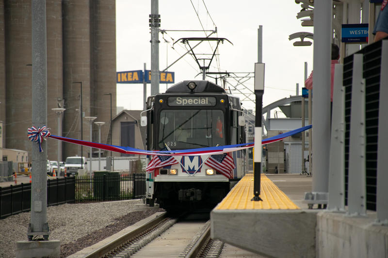 A train of spectators broke a ribbon at Cortex MetroLink Station on Tuesday morning. July 31, 2018.