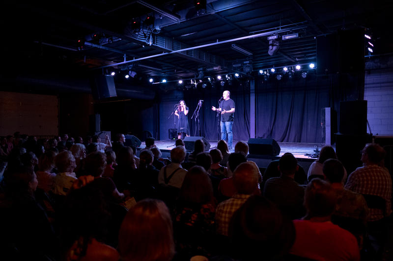 St. Louis Public Radio's Science Reporter Eli Chen and local comedian and writer Zack Stovall welcome the crowd at The Ready Room for the June 28th Story Collider: Homing Signals.