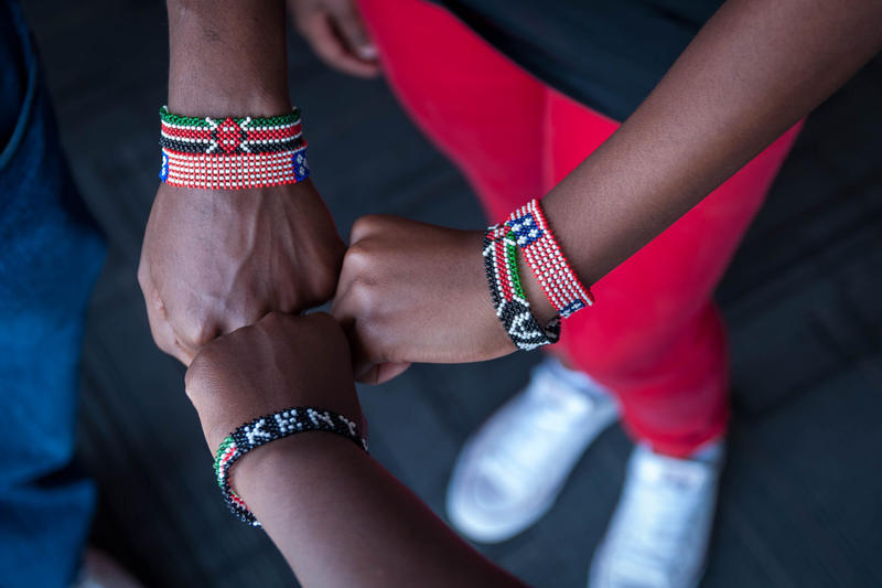 Geoffrey Soyiantet, Sally Gacheru and Gracemary Nganga compare their Kenyan beed bracelets. Several teens from the St. Louis area are now in their home country of Kenya for about two weeks through Soyiantet's Vitendo4Africa organization.