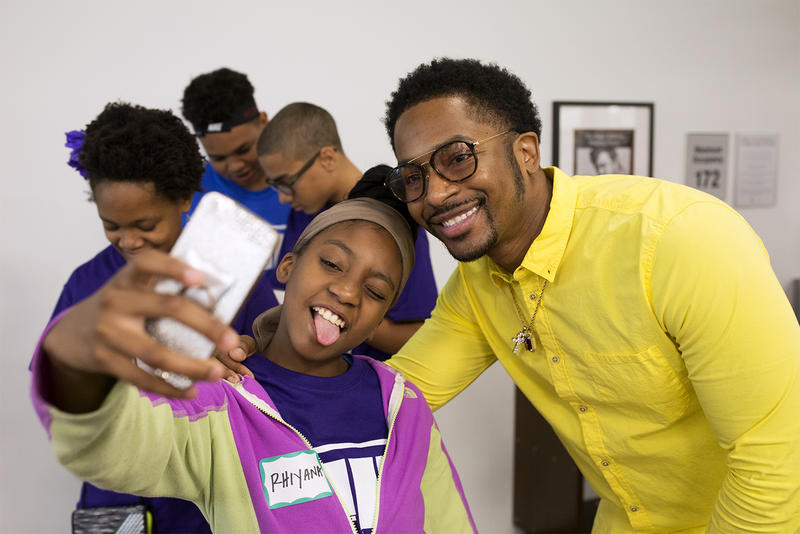 Rhiyana Jackson and Chingy pose for a selfie at St. Louis County Library on Natural Bridge Road. Rhiyana's rap about violence, education and housing was one of a few verses selected to be in a Hip-Hop Architecture Camp music video.