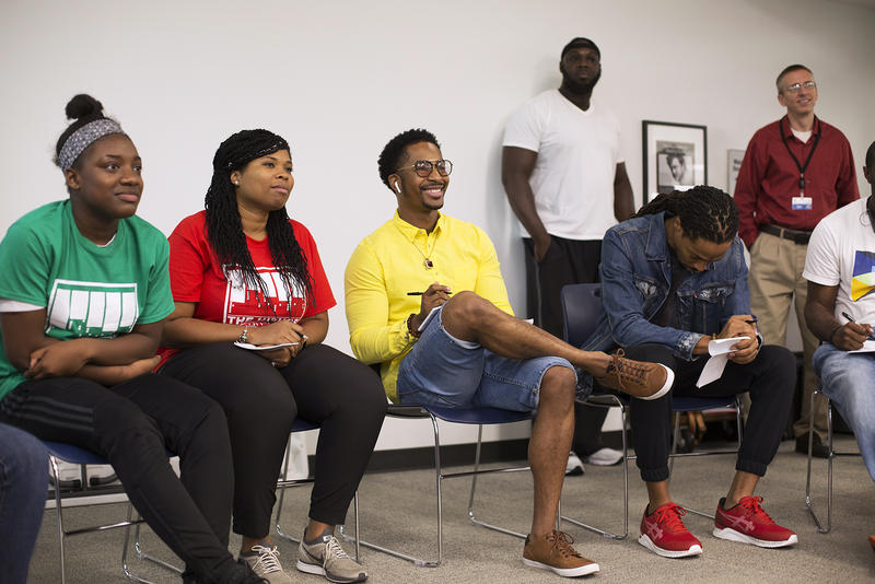 Chingy listens to students rap about their communities at Hip-Hop Architecture Camp at St. Louis County Public Library.