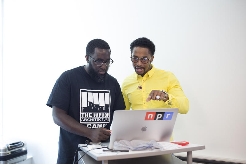 Architect and camp founder Michael Ford works with Chingy on the students' rap song.
