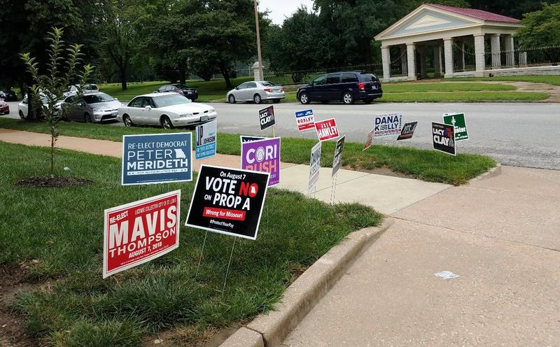 Candidate signs outside a polling place in St. Louis' Shaw neighborhood on August 7, 2018.