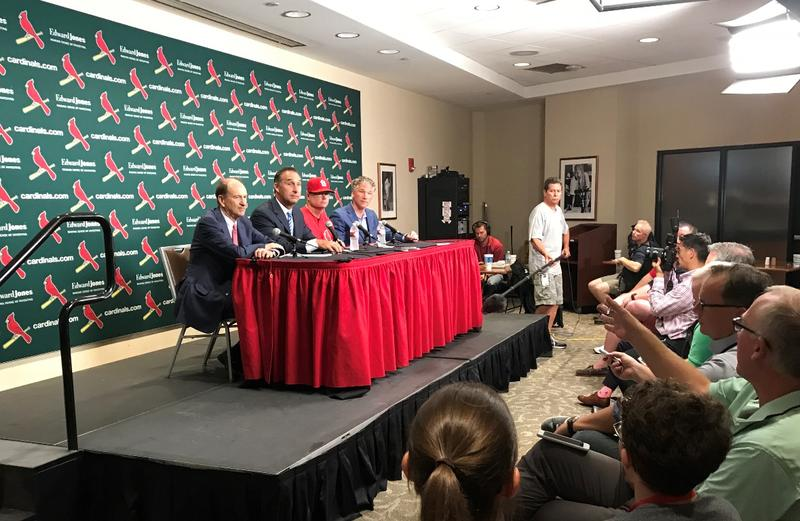 St. Louis Cardinals manager Mike Shildt (third from left) and front office officials answers questions on August 28, 2018 after giving Shildt a two-year contract as manager.