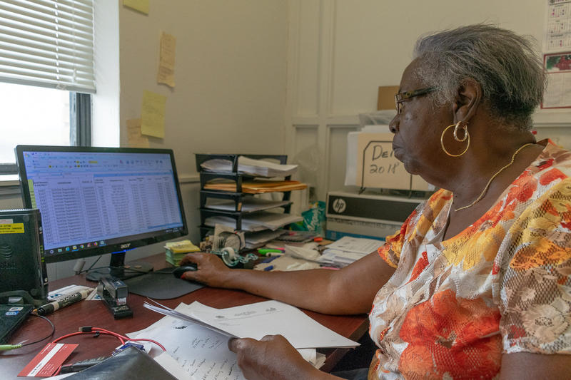 Delonia Winston shows a St. Louis Public Radio reporter one spreadsheet she keeps that tracks maintenance of Northside Regeneration-owned properties.