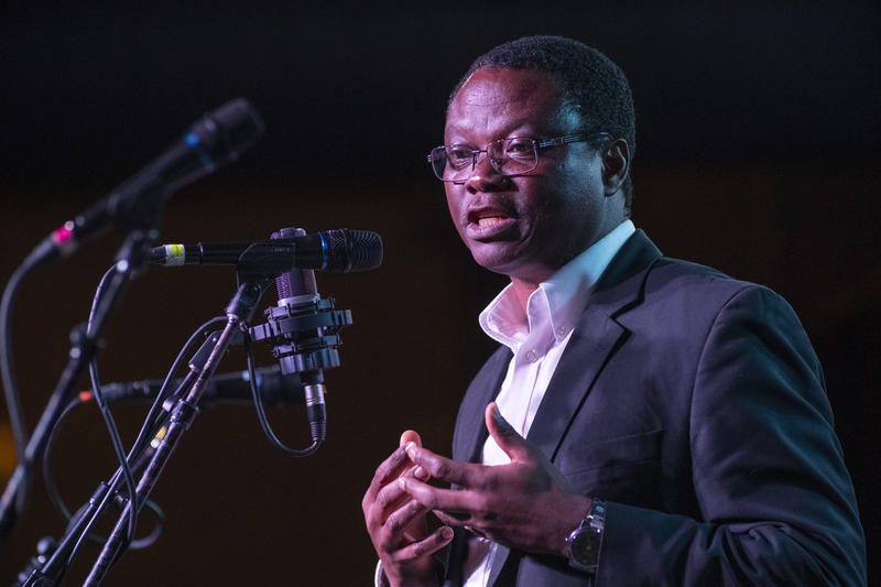 Cancer researcher Samuel Achilefu telling a story at the Story Collider podcast's live taping at the Ready Room in June 2018.