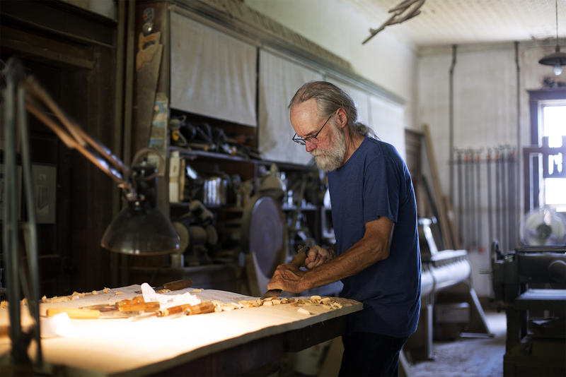 Michael Bauermeister works on a piece in his studio in early July. July, 2018.