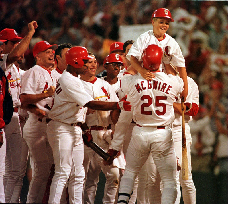 St. Louis Cardinals first baseman Mark McGwire lifts his 10-year-old son, Matt, after hitting his 62nd home run of the 1998 season on Sept. 8, 1998, breaking Roger Maris' record.