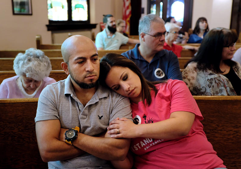 "Alex and Carly Garcia listen to a Sunday sermon which kicked off a ""week of action"" in support of their family."