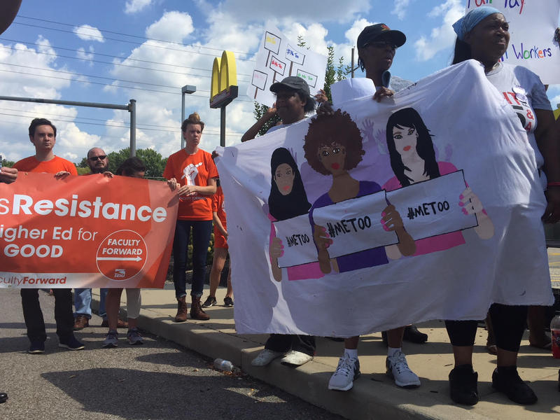 Activists rally outside a McDonald's in St. John. Sept. 18, 2018.
